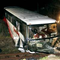 42 injured as tour bus plunges onto railway track in southwest Japan