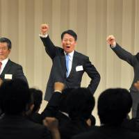 In the line of fire: Democratic Party of Japan President Banri Kaieda, who is being sued for allegedly misleading investors, expresses his resolve to lead the party Dec. 25 after being elected DPJ chief. | YOSHIAKI MIURA