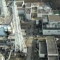 Stricken: An image taken by a T-Hawk drone aircraft in April 2011 and released by Tokyo Electric Power Co. shows the damaged building (left) that houses reactor 4 at the Fukushima No. 1 nuclear plant. | AP