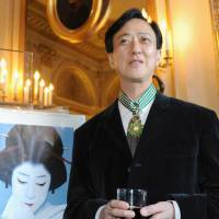 Prestige: Kabuki actor Bando Tamasaburo poses after receiving the Commander of the Order of Arts and Letters award, one of France's highest cultural medals, on Tuesday in Paris. | KYODO