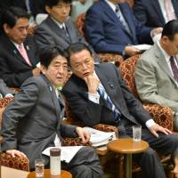Comfort drink: Prime Minister Shizo Abe's thermos bottle is within reach Tuesday during a House of Councilors Budget Committee session. | AFP-JIJI