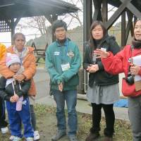 Volunteers return from abroad to aid Tohoku