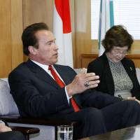 Energizer: Actor and former California Gov. Arnold Schwarzenegger gestures Friday while discussing global warming and energy issues with Environment Minister Nobuteru Ishihara at the latter's office. | KYODO