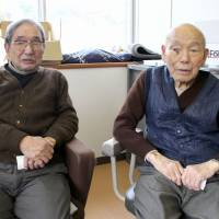 Katsumi Iwataki (left), 88, and Wahei Hara, 94, recount their memories of the disputed territory in Okinoshima on Jan. 23. | KYODO