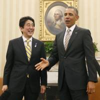 TPP talks are go: U.S. President Barack Obama and Prime Minister Shinzo Abe are all smiles after emerging from their summit talks at the  White House on Friday. | KYODO