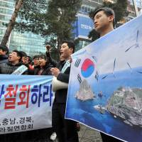 Not in dispute: High school students attend an anti-Japan rally outside the Japanese Embassy in Seoul on Friday to denounce Tokyo's territorial claim to a pair of islets controlled by South Korea in the Sea of Japan. | AFP-JIJI