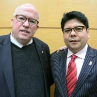 Gay consul general finds partner, place in government
