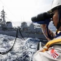 Far from home: The Maritime Self-Defense Force destroyer Sazanami is refueled in the Gulf of Aden in June 2009 during Japan's antipiracy operations. | KYODO