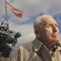 Semper fi: Norman Hatch poses for a photo near the U.S. Marine Corps War Memorial on Feb. 20 in Arlington, Virginia. | THE WASHINGTON POST