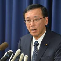 Final authority: Justice Minister Sadakazu Tanigaki holds a press conference Thursday after three death row inmates were executed.  | AFP-JIJI
