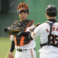 Ready to go: Yomiuri Giants captain Shinnosuke Abe (10) and his teammates begin preparations for the upcoming season on Friday in Miyazaki. | KYODO