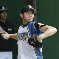 Let's get started: Hokkaido Nippon Ham rookie Shohei Otani pitches at the team's training camp in Kunigami, Okinawa, on Sunday. | KYODO