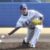 Seibu Lions right-hander Kazuhisa Makita  pitches during a practice game at the Pacific League club's spring training facility in Miyazaki Prefecture. | KYODO