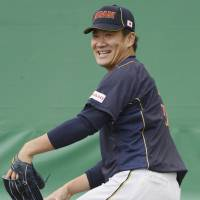 Calm before the storm: Masahiro Tanaka pitches during Japan's final day of training camp on Thursday in Miyazaki. | KYODO