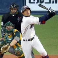 Late heroics: Catcher Ryoji Aikawa smacks a game-winning three-run homer in the eight inning as Japan topped Australia 3-2 in an exhibition game on Saturday in Osaka. | KYODO
