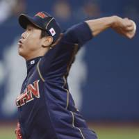 Solid work: Japan southpaw Tetsuya Utsumi pitched three scoreless innings of one-hit ball against the Hanshin Tigers on Tuesday in Osaka. The Tigers defeated Japan 1-0 in a WBC warmup game.  | KYODO