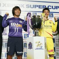 Back in action: Saturday's Xerox Super Cup gives Sanfrecce Hiroshima manager Hajime Moriyasu (far left) and his Kashiwa Reysol counterpart Nelsinho (far right) a chance to see their teams in action before the 2013 J. League  season officially begins. | KYODO