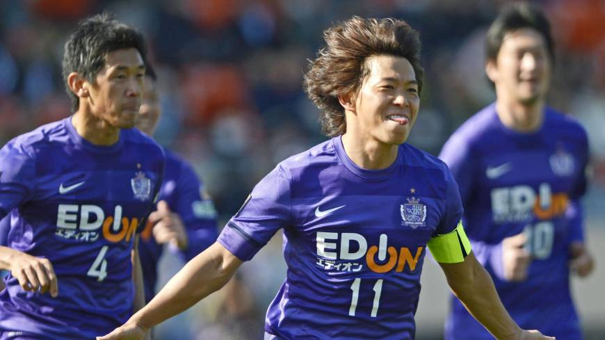 Purple reign: Sanfrecce Hiroshima's Hisato Sato (center) celebrates after scoring against Kashiwa Reysol in the 29th minute of the Xerox Super Cup on Saturday at Tokyo's National Stadium. Sanfrecce won 1-0.