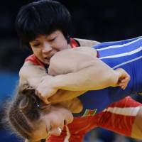 Down for the count?: Hitomi Obara (top) captured one of Japan's four wrestling golds at the London Games. | AP