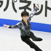 In control: Yuzuru Hanyu earns 87.65 points skating to 'Parisian Walkways' during the men's short program at the Four Continents Figure Skating Championships on Friday in Osaka. Hanyu is the leader after the first day of competition. | KYODO