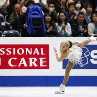 Flying colors: Mao Asada performs her free-skate routine at the Four Continents Figure Skating Championships in Osaka on Sunday. Mao won the event with a combined total of 205.45 points. | AP