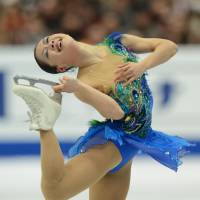 Perpetual motion: Akiko Suzuki performs her free-skate routine in Osaka on Sunday. | AFP-JIJI