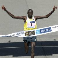 Record breaker: Kenya's Dennis Kimetto crosses the finish line to win the Tokyo Marathon on Sunday. | AP
