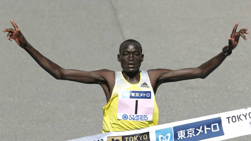 Record breaker: Kenya's Dennis Kimetto crosses the finish line to win the Tokyo Marathon on Sunday.
