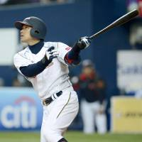 Samurai showdown: Ryoji Aikawa and Japan have a tough road ahead of them at the 2013 World Baseball Classic. | KYODO