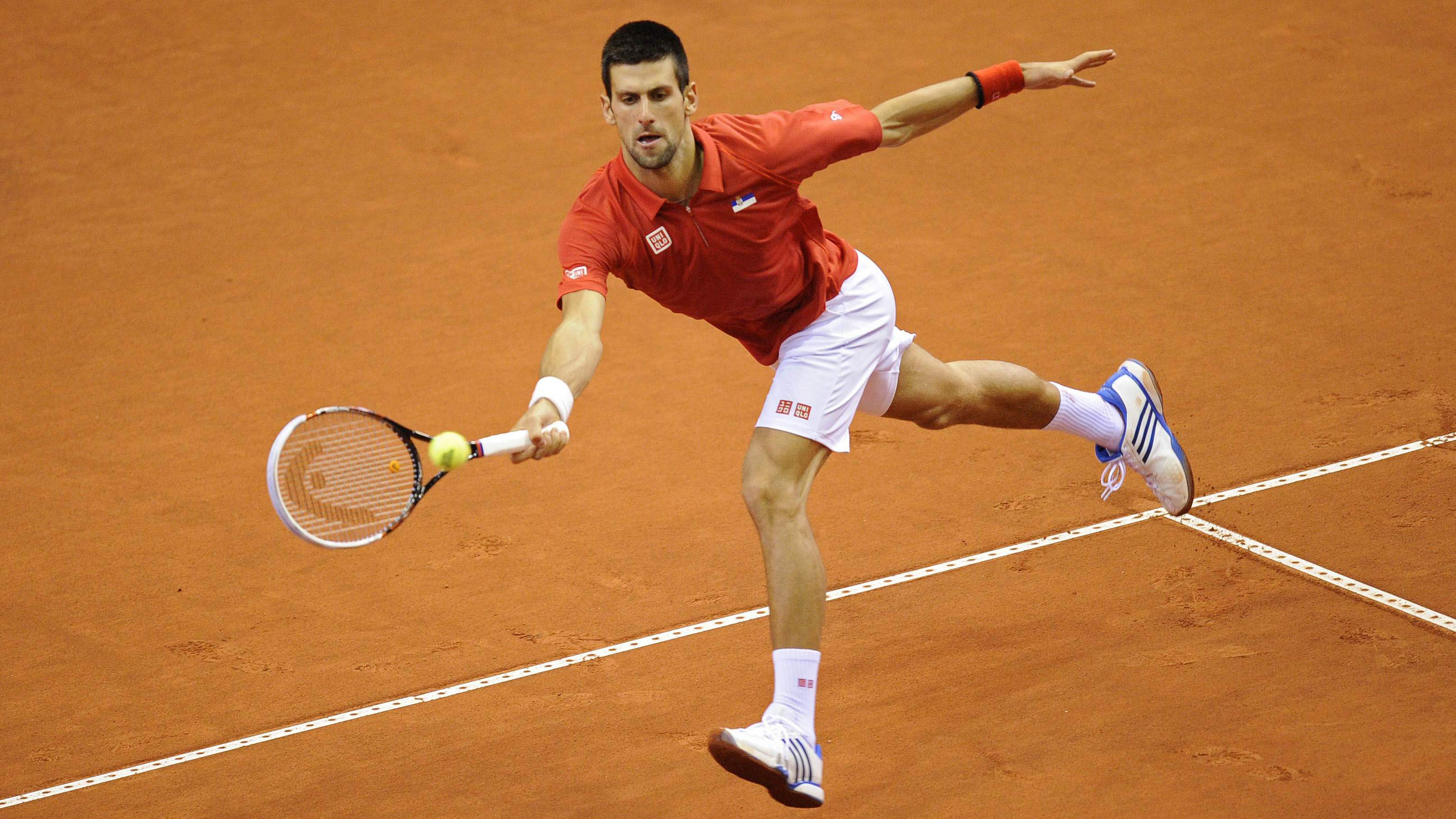 Court concerns: Serbia's Novak Djokovic runs down a shot from Belgium's Olivier Rochus in their Davis Cup singles match on Friday in Charleroi, Belgium. Djokovic won 6-3, 6-2, 6-2 to help give Serbia a 2-0 lead in the tie. | AFP-JIJI