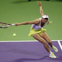 Back at you: Caroline Wozniacki hits a return during her match against Mervana Jugic-Salkic at the Qatar Total Open Monday. Wozniacki won 6-1, 6-2. | AP