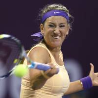 Full force: Victoria Azarenka of Belarus plays a shot during her 6-2, 6-3 second-round victory over Switzerland's Romina Oprandi at the Qatar Total Open on Wednesday. | AFP-JIJI