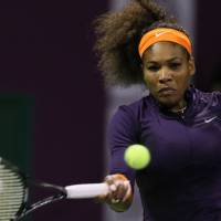Climbing the mountain: Serena Williams moved within a win of reclaiming the No. 1 world ranking with her 6-0, 6-3 victory over Urszula Radwanska at the Qatar Total Open on Thursday. | AP