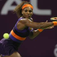 Golden oldie: Serena Williams plays a shot during her 3-6, 6-3, 7-5 win over Petra Kvitova at the Qatar Total Open on Friday. | AFP-JIJI