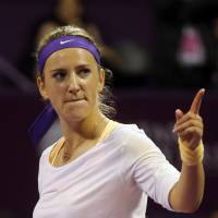 One for the road: Outgoing world No. 1 Victoria Azarenka gestures during the Qatar Total Open final on Sunday. Azarenka defeated her successor at No. 1, Serena Williams, 7-6 (8-6), 2-6. 6-3. | AP