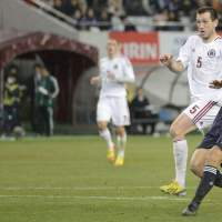 Okazaki strikes twice as Japan rolls over Latvia