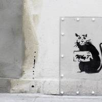 Mystified: A new graffiti work of a rat asking 'Why?' has been placed next to a section of a wall where street artist Banksy's 'slave labor' artwork was removed in London. | AFP-JIJI