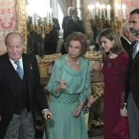 Royal house in limbo: Spain's King Juan Carlos (left) waits during a reception with Queen Sofia (second from left), Princess Letizia and Prince Felipe at the Royal Palace in Madrid on Jan. 23. | AP