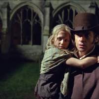 City of dark: Hugh Jackman as Jean Valjean and Isabelle Allen as the young Cosette in the film version of Victor Hugo's 'Les Miserables.' | AP