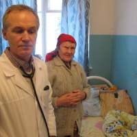 The doctor is in: Dr. Sergei Vishnyakov stands with 72-year-old patient Alexandra Tikhomirova at his hospital in Itomlya, Russia. | THE WASHINGTON POST