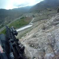 Not a video game: This screen grab from video captured by army Pfc. Ted Daniels' helmet camera shows a shell casing being discharged from his weapon as he returns fire during an April 2012 firefight on a hillside in Afghanistan. | THE WASHINGTON POST