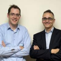 Powers of persuasion: Behavioral Insights Team Director David Halpern (right) and Deputy Director Owain Service pose for a photograph in London on Jan. 14. | AFP-JIJI