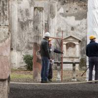 City turned to stone: Italian restorers work on the Casa dei Dioscuri in Pompeii on Wednesday. | AFP-JIJI