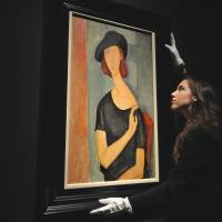 Tragedy of a portrait: 'Jeanne Hebuterne (Wearing a Hat)' by Amedeo Modigliani is displayed in London. | AFP-JIJI