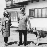 The banality of evil: Eva Braun and Adolf Hitler pose with their dogs in Berchtesgaden. Braun's home movies, uncovered by artist Lutz Becker in the 1970s, offer a remarkably unmediated view of Hitler and of the Nazi high command. | BUNDESARCHIV