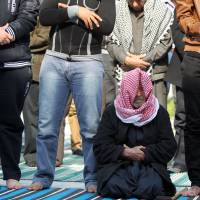 Protest central: Sunni Muslim men attend prayers at Baghdad's Abu Hanifa mosque Friday. | AFP-JIJI