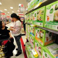 Stocking up: Pregnant Chinese women shop for baby products at a department store in the San Gabriel Valley, east of Los Angeles, on Jan. 31. | AFP-JIJI