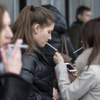 Russia's smokers huff and puff over new ban