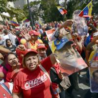 Return of the king: Supporters of Venezuelan President Hugo Chavez gather in Caracas to celebrate his return to the country from Cuba on Monday. | AFP-JIJI