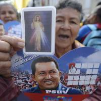 The faithful: Supporters of Venezuelan President Hugo Chavez gather in Caracas to celebrate his return to the country after a 10-week convalescence in Cuba on Monday following cancer surgery. | AFP-JIJI